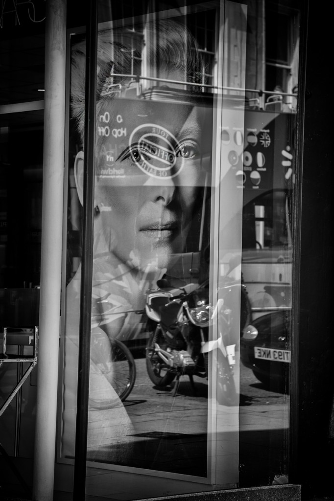 facial reflection-UK street Photography
