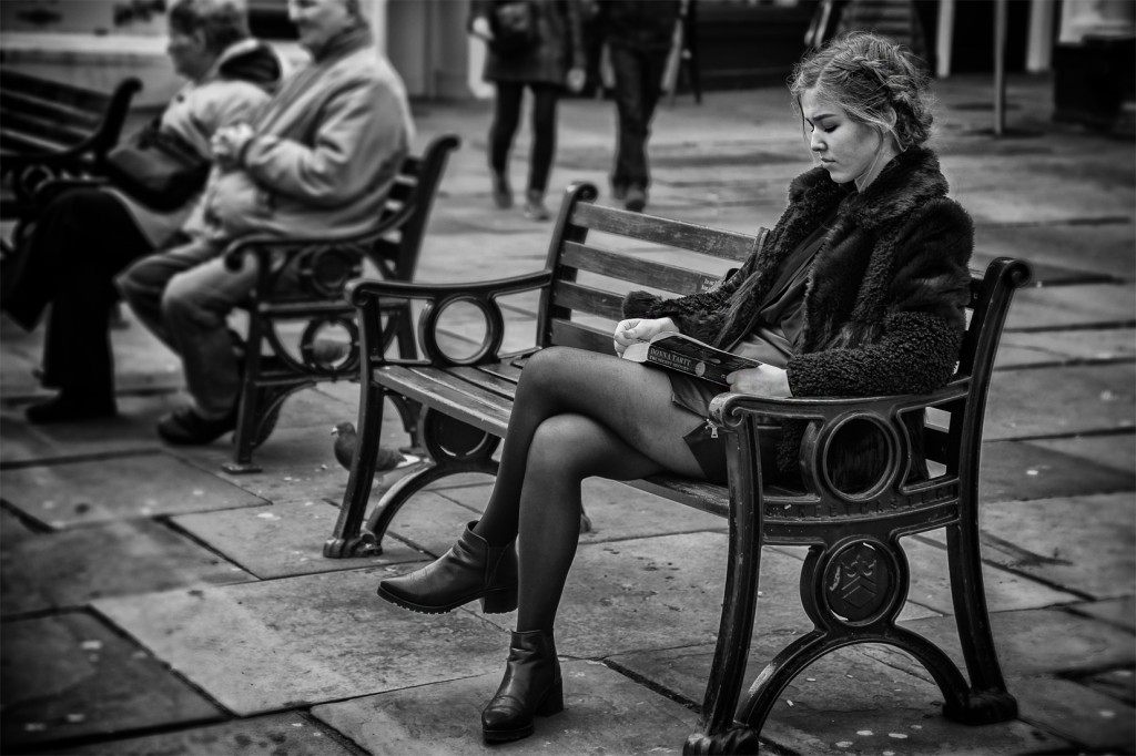 girl reading - UK street Photography