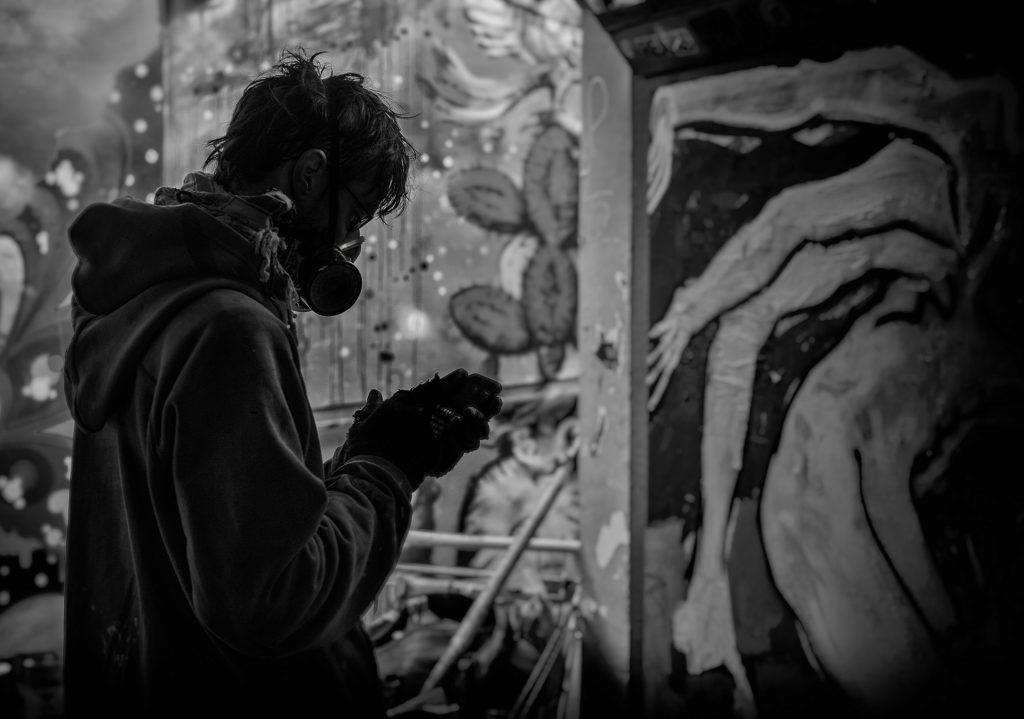 Masked graffiti artist -bristol street photography